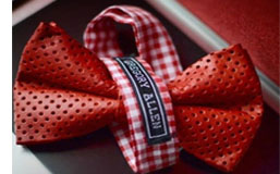 red perforated leather bow tie_blog sidebar